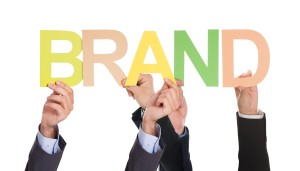 businesspeople-holding-the-word-brand