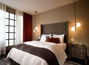 A rendering of a bedroom in a West Elm hotel.